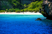 secluded beach blue waters