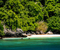 secluded white beach swimming diving