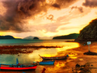 warm sunset red and blue long tail boats red sky impression