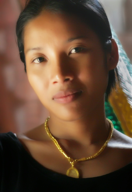 soft warm glow young Thai woman