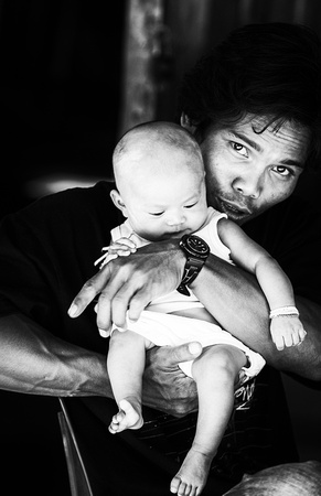 Asian father with child B/W